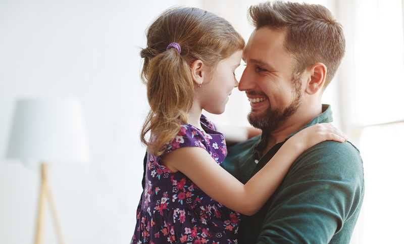 Father's Day. Happy Family Daughter Hugs His Dad